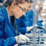 MicroCare: woman works on factory floor