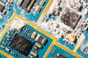 Cleaning printed circuit board assembly