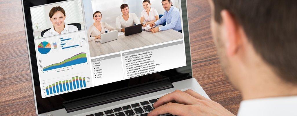man looking at webinar screen